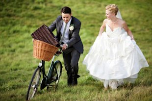 It's cute 'til you realize he has to get all the guests to the wedding in the basket, too. (Getty Images)