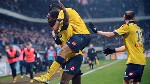 FRANCE, Montbéliard : Sochaux' French forward Giovanni Sio (L) jubilates after scoring a goal during the French L1 football match Sochaux (FCSM) vs Paris (PSG) at the Auguste Bonal Stadium in Montbeliard on February 17, 2013. (AFP)