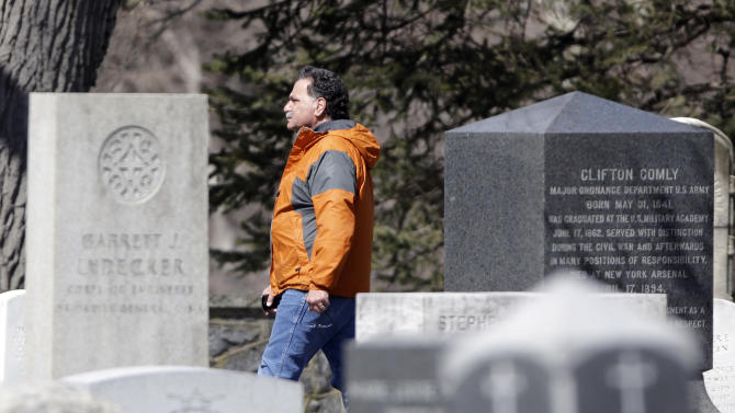 Steve Denardis of the Army Corps. of Engineers walks in the West Point Cemetery on his lunch break on Friday, March 22, 2013, in West Point, N.Y. Graves of soldiers from every U.S. war make this small plot of the land the most hallowed ground on the nation's the most venerable military academy. And after 196 years and more than 8,000 souls, it's close to full. (AP Photo/Mike Groll)