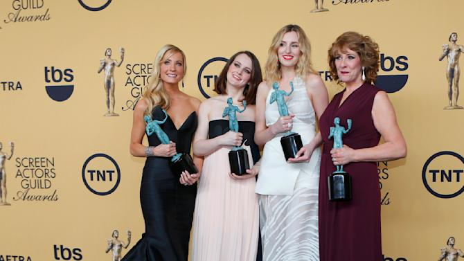 "Actresses Froggatt, McShera, Carmichael and Logan of the television  series ""Downton Abbey"" pose backstage with their award for Outstanding Performance by an Ensemble in a Drama Series at the 21st annual Screen Actors Guild Awards in Los Angeles"