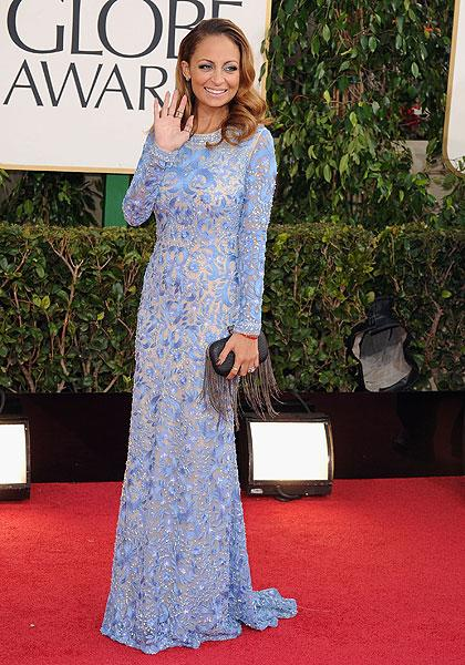 Nicole Richie: Nicole has ditched her bad girl image for good in this subtle but sexy Naeem Khan gown. The long sleeves and train gives it an Old Hollywood throwback while the clutch with long feathers (or are those tassles) give the look a more modern edge. (Photo by Steve Granitz/WireImage)