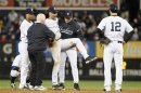 New York Yankees Shortstop Jeter Is Carried Off The Field By Trainer Donohue And Manager Girardi After Injuring Himself While Playing Against The Detroit Tigers During The 12th Inning Of Game 1 Of Their MLB ALCS Playoff Baseball Series In New York