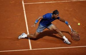 Nadal of Spain returns the ball to compatriot Bautista Agut during their men's singles semi-final match at the Madrid Open tennis tournament
