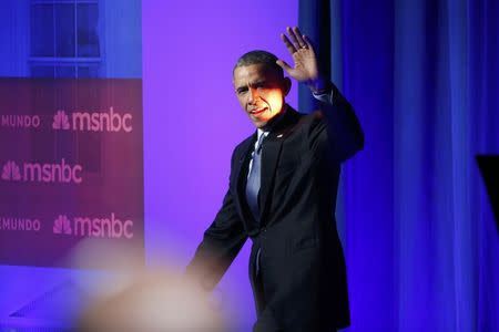 On Bush turf, Obama blames immigration woes on Republicans