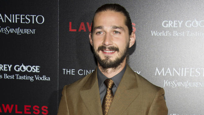 """FILE - In this Aug. 13, 2012 file photo, Shia LaBeouf attends a screening of """"Lawless"""" hosted by The Weinstein Company and The Cinema Society in New York. LaBeouf appears completely nude in Sigur Rós' new music video in Lars Von Trier's """"The Nymphomaniac."""" LaBeouf can next be seen in """"Lawless,"""" opening Wednesday, about a West Virginia moonshine business during the Prohibition era. (Photo by Charles Sykes/Invision/AP, File)"""