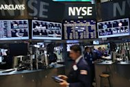 <p>Traders work on the floor of the New York Stock Exchange. Expectant eyes from around the world will be on Ben Bernanke Friday, looking for assurances that the US economy is solid or, if not, that his Federal Reserve is ready to invest more to stimulate growth.</p>