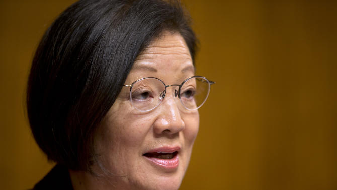 FILE - In this March 18, 2013, file photo, Sen. Mazie Hirono, D-Hawaii, holds a hearing in the Senate Judiciary Committee about immigrant women and immigration reform on Capitol Hill in Washington. For all the soothing words she heard from fellow Democrats on the Senate Judiciary Committee, Hirono never had a chance to win a relatively modest change to far-reaching immigration legislation. Instead, the hidden hand of the bipartisan Gang of Eight reached out and rejected her attempt to create an immigration preference for close relatives of citizens with an extreme hardship _ the same force that had already derailed dozens other proposals deemed to violate the delicate trade-offs made by the bill's bipartisan authors. (AP Photo/Jacquelyn Martin, File)