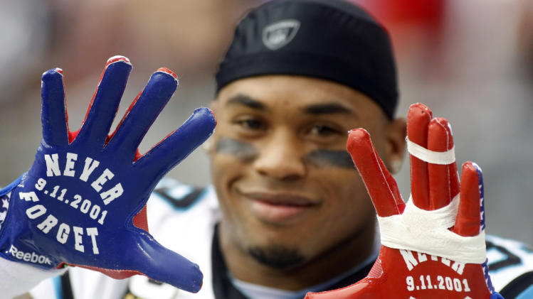 Carolina Panthers wide receiver Steve Smith displays his gloves prior to an NFL football game against the Arizona Cardinals, Sunday, Sept. 11, 2011, in Glendale, Ariz. Sunday was the 10th anniversary of the 9/11 attacks. (AP Photo/Ralph Freso)