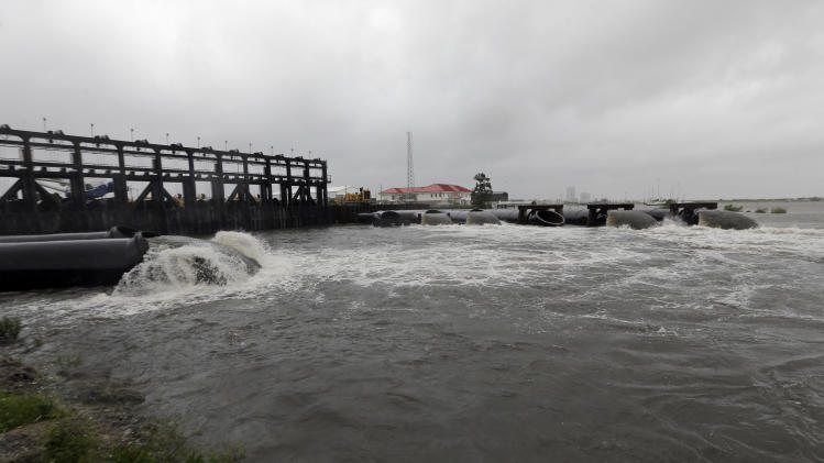 This Wednesday, Aug. 29, 2012 photo shows the new 17th Street Canal pumping station as Hurricane Isaac hit New Orleans. (AP Photo/David J. Phillip)