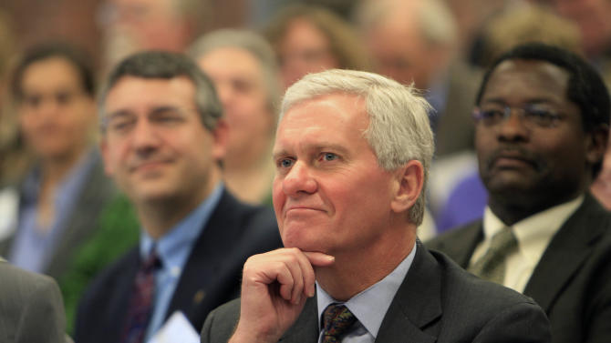 University of New Hampshire president Mark Huddleston listens during a forum with The University of New Hampshire and community colleges on how to increase the number of  Science, Technology, Engineering, and Mathematics  graduates in New Hampshire to meet workforce needs. , Tuesday, Nov. 27, 2012 in Manchester, N.H. (AP Photo/Jim Cole)