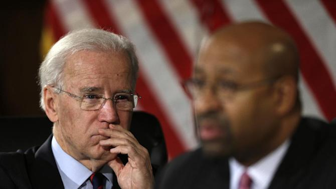 Vice President Joe Biden listens to Philadelphia Mayor Michael Nutter speaks after a round table discussion on gun control with elected and law enforcement officials, Monday, Feb. 11, 2013, at Girard College in Philadelphia. (AP Photo/Matt Rourke)