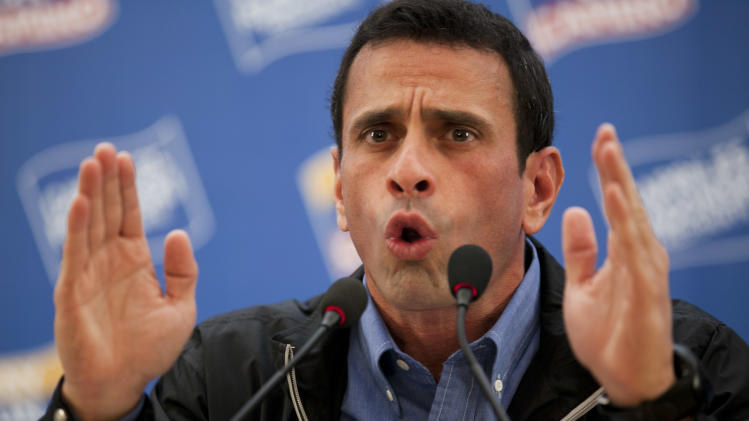 Opposition presidential candidate Henrique Capriles speaks during a news conference in Caracas, Venezuela, Tuesday, June 26, 2012. Capriles will challenge Venezuela's President Hugo Chavez in the presidential elections scheduled for Oct. 7. (AP Photo/Ariana Cubillos)