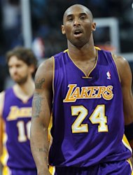 Los Angeles Lakers guard Kobe Bryant, front, reacts after being called for a foul as forward Pau Hasol, back, of Spain, looks on against the Denver Nuggets in the third quarter of the Nuggets&#39; 113-96 victory in Game 6 of the teams&#39;  first-round NBA basketball series in Denver on Thursday, May 10, 2012. (AP Photo/David Zalubowski)