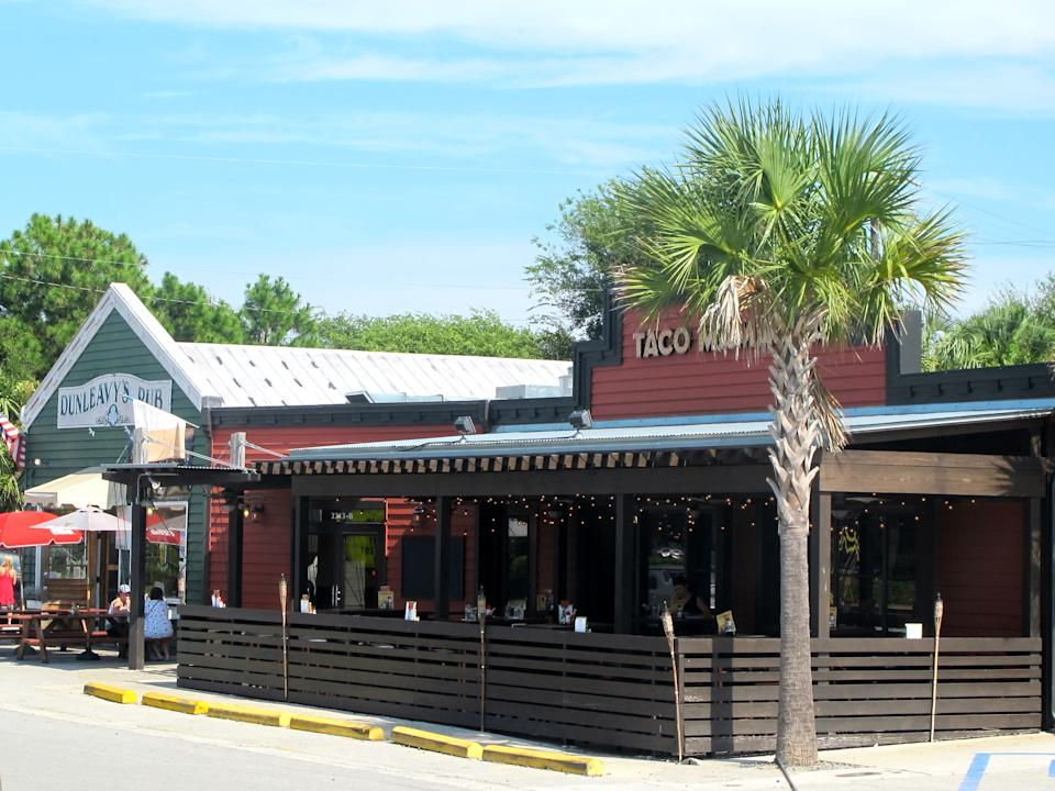 Restaurants in the restaurant district on Sullivans Island, S.C., are seen in this Sept. 12, 2013 photo. There are about a dozen restaurants on Sullivans Island just outside Charleston, S.C. (AP Photo/Bruce Smith)