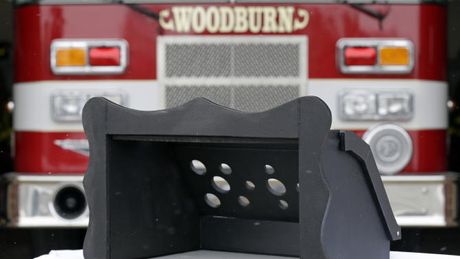 A prototype of a baby box, where parents could surrender their newborns anonymously, is shown outside the fire station in Woodburn, Ind., Thursday, Feb. 26, 2015. The box is actually a newborn incubator, or baby box, and it could be showing up soon at Indiana hospitals, fire stations, churches and other selected sites under legislation that would give mothers in crisis a way to surrender their children safely and anonymously. (AP Photo/Michael Conroy)