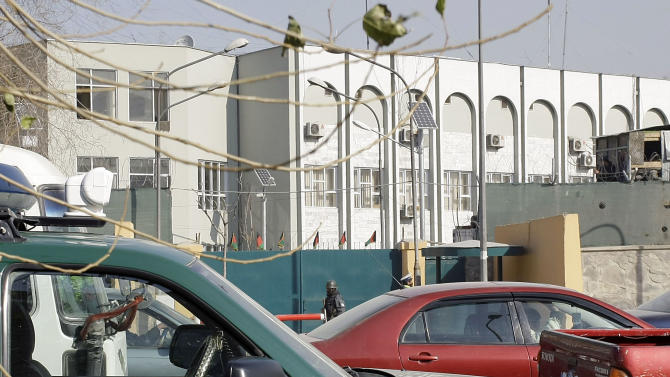 An Afghan policeman stands  guard outside of  Kabul police headquarters gate, where an American advisor was killed in Kabul, Afghanistan, Monday, Dec. 24, 2012. An Afghan policewoman killed an American adviser at the Kabul police headquarters on Monday, a senior Afghan police official said. (AP Photo/Musadeq Sadeq)