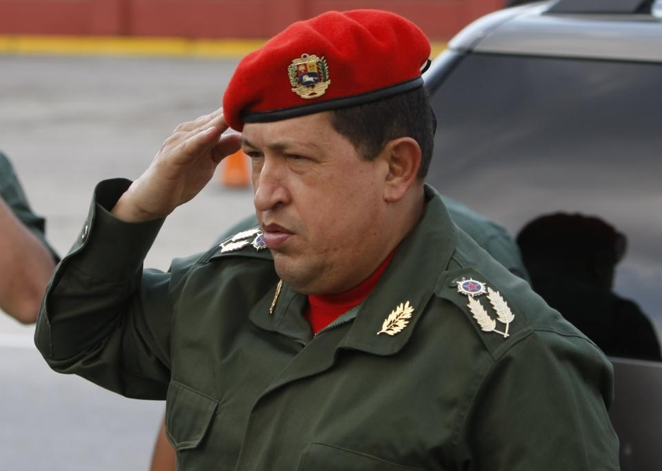 Venezuela's President Hugo Chavez salutes upon his arrival to the Fort Tiuna military base to welcome Ecuador's President Rafael Correa in Caracas, Venezuela, Tuesday, Dec. 14, 2010. Correa comes to Venezuela for a one-day visit.(AP Photo/Fernando Llano)