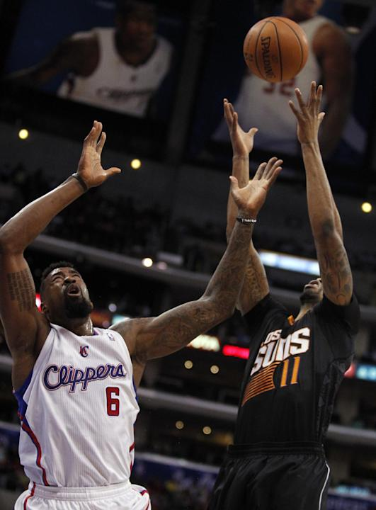 Los Angeles Clippers center DeAndre Jordan (6) battles for a rebound against Phoenix Suns forward Markieff Morris (11) during the first half of an NBA basketball game Monday, March 10, 2014, in Los An