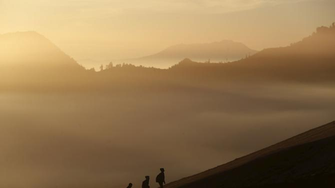 People climb the slope of Bromo mountain to attend the Kasada Festival in Probolinggo