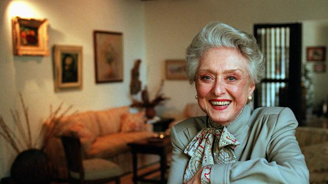 """FILE- In this March 12, 1997, file photo, actress Celeste Holm poses at a friends' home in Santa Monica, Calif. Celeste Holm, a versatile, bright-eyed blonde who soared to Broadway fame in """"Oklahoma!"""" and won an Oscar in """"Gentlemen's Agreement"""" but whose last years were filled with financial difficulty and estrangement from her sons, died Sunday, July 15, 2012,  a relative said. She was 95.(AP Photo/Kevork Djansezian, File)"""