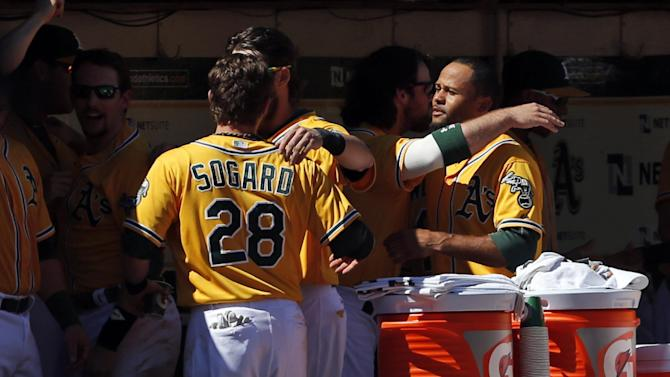 Athletics beat Twins 11-7, capture AL West again