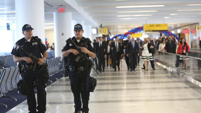 Heavily armed Port Authority police officers patrol the Delta airlines terminal 4 at JFK airport, Friday, May 24, 2013 in New York. Delta opened its $1.4 billion terminal, strengthening its hand in the battle for the lucrative New York travel market. The expanded concourse offers sweeping views of the airport, upscale food and shopping options and increased seating. It replaces a decrepit terminal built by Pan Am in 1960 that was an embarrassing way to welcome millions of visitors to the United States. (AP Photo/Mary Altaffer)