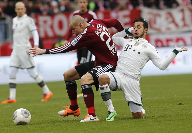 Nuremberg's Adam Hlousek of Czech Republic, left, and Bayern's Thiago Alcantara of Spain challenge for the ball during a German first  division Bundesliga soccer match  between 1.FC Nuremberg