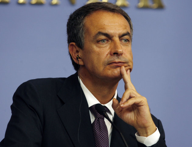 FILE - In this Tuesday, Sept. 6, 2011 file photo Spanish Prime Minister Jose Luis Rodriguez Zapatero listens to a question during a news conference in Ankara, Turkey, . French President Nicolas Sarkoz