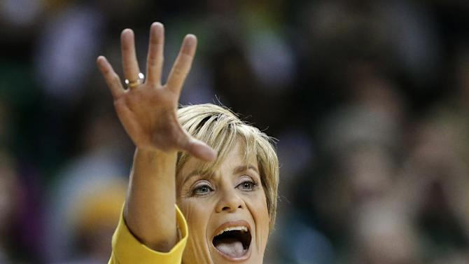 FILE - In this Jan. 19, 2013, file photo, Baylor head coach Kim Mulkey instructs her team in the first half of an NCAA college basketball game against West Virginia in Waco, Texas. (AP Photo/Tony Gutierrez, File)