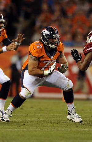 FILE - Denver Broncos guard John Moffitt plays against the Arizona Cardinals during a pre-season NFL football game on Thursday, Aug. 29, 2013, in Denver. Moffitt says he quit the NFL this week not because he was unhappy with a lack of playing time in Denver but because he'd lost his love for the game and was tired of risking his health. The Broncos put him on their reserve/left team list on Tuesday Nov. 5, 2013 when they activated center J.D. Walton from the physically unable to perform list. (AP Photo/Jack Dempsey, File)