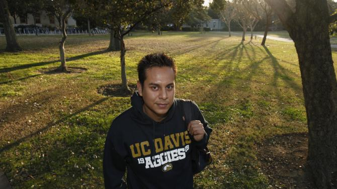 In this Dec. 12, 2011 photo, Irvis Orozco, 24, a senior studying international relations at the University of California, Davis, poses on campus in Davis, Calif. A new law that will take effect Jan. 1, 2012, will allow Orozco, who was brought to the country illegally from Mexico when he was an infant, to receive private financial aid at California's public colleges. (AP Photo/Rich Pedroncelli)