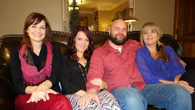 Joe Darger with his wives (left to right) Alina, Valerie and Vicki Darger at their family home in Salt Lake City, Utah, where polygamy has been ruled to be legal