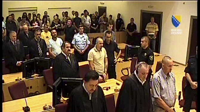 Image made from TV provided by Bosnian war crimes court showing former Bosnian Serb soldiers Franc Kos, first row right, Stanko Kojic second row center, Vlastimir Golijan third row center, and Zoran Goronja, forth row right, during the pronouncement of the verdict for the four Bosnian Serb soldiers in Sarajevo, Bosnia, on Friday, June 15, 2012. Bosnian court on Friday convicted the four former elite soldiers of crimes against humanity for their part in the 1995 Srebrenica massacre and handed down sentences of up to 43-years. Bosnian Serb Stanko Kojic was sentenced to 43 years in prison; Slovenian Franc Kos and Bosnian Serb Zoran Goronja both got 40 years; and Vlastimir Golijan received a 19-year prison sentence.(AP Photo/Bosnian war crimes court)