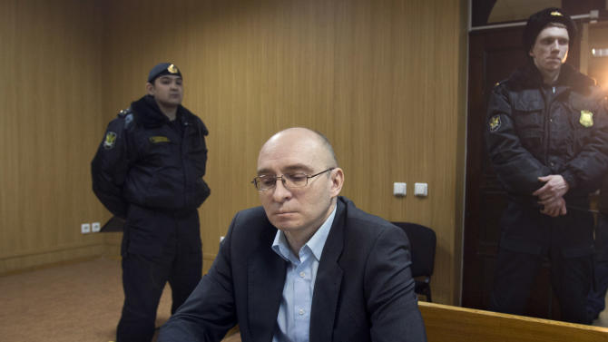 Dmitry Kratov, sits in a court, in Moscow, Russia, Friday, Dec. 28, 2012. The Tverskoy court on Friday will rule in the case of Dmitry Kratov, formerly deputy chief physician in the Butyrskaya prison, the only official charged with the lawyer's death. The Moscow court is expected to hand down a verdict on Friday for the first and only official charged with the death of whistleblowing lawyer Sergei Magnitsky in a case his family dismissed as sham and humiliation. (AP Photo/Misha Japaridze)