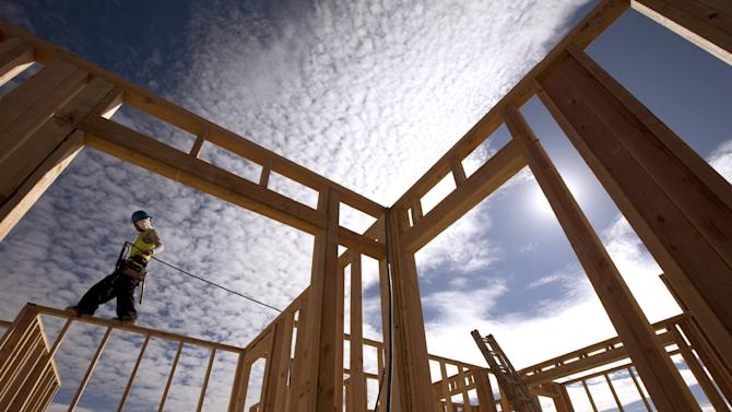 """FILE - In this Friday, Nov. 16, 2012 file photo, construction worker Elabert Salazar works on a house frame for a new home in Chula Vista, Calif. If Washington lawmakers can get past the """"fiscal cliff,"""" many analysts say that the outlook for stocks in 2013 is good, as a recovering housing market and an improving jobs outlook helps the economy maintain a slow, but steady recovery. (AP Photo/Gregory Bull, File)"""