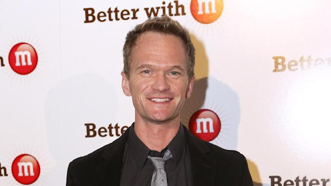 "IMAGE DISTRIBUTED FOR MARS CHOCOLATE NORTH AMERICA - Neil Patrick Harris makes an appearance at the ""Better With M"" Kick-Off Event on Thursday, Jan. 31, 2013 in New Orleans. (Jonathan Bachman/AP Images for Mars Chocolate North America)"