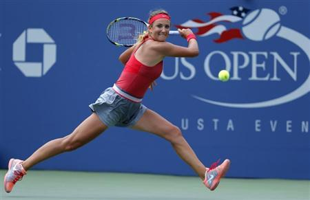 Azarenka of Belarus hits a return to Cornet of France at the U.S. Open tennis championships in New York