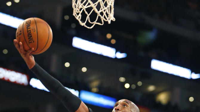 Los Angeles Lakers' Kobe Bryant puts up a shot in the first half of an NBA basketball game against the Los Angeles Clippers in Los Angeles on Friday, Oct. 31, 2014. (AP Photo/Christine Cotter)