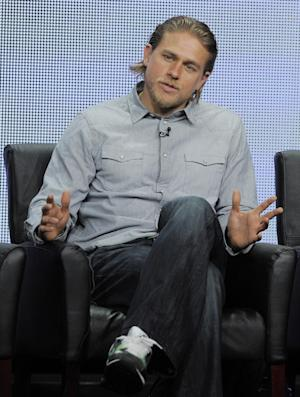 """FILE - In this Friday, Aug. 2, 2013 file photo, Charlie Hunnam, a cast member in the FX series """"Sons of Anarchy,"""" answers a reporter's question during the FX 2013 Summer TCA press tour in Beverly Hills, Calif. NBC-Universal employees have been told the recasting of Christian Grey in the company's film version of the erotic best-seller """"Fifty Shades of Grey"""" will be finalized in the next few weeks. A company-wide """"town hall"""" on Wednesday, Oct. 16, 2013, covered a variety of subjects but """"Fifty Shades"""" was the inevitable hot topic in the wake of last weekend's stunning announcement that Charlie Hunnam was dropping out of the Christian Grey role, according to an NBC-Universal employee who attended the meeting. (Photo by Chris Pizzello/Invision/AP)"""