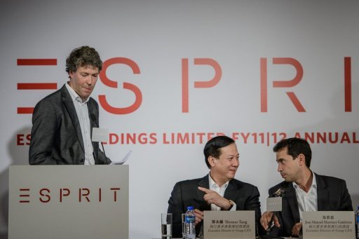 <p>Esprit executive director and group CEO Thomas Tang (C), seen next to newly appointed Esprit chief executive Jose Manuel Martinez Gutierrez (R) as his predecessor Ronald van der Vis ends his speech during an annual results press conference in Hong Kong, on September 26. Esprit plans to raise up to $677 mln in a new share sale to rebuild its brand, according to a report.</p>
