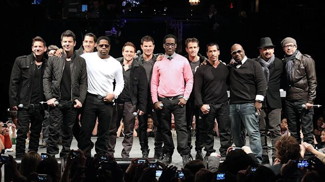"""This picture provided by Starpix shows members of 98 Degrees, Boyz II Men, and New Kids on the Block, during the announcement of """"The Package Tour,"""" Tuesday, Jan. 22, 2013 in New York. The major summer tour will feature the three bands. (AP Photo/Starpix, Kristina Bumphrey)"""