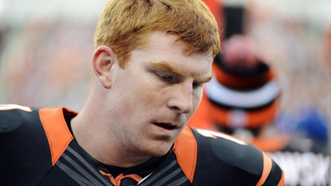 Cincinnati Bengals quarterback Andy Dalton stands on the sidelines after throwing an interception in the fourth quarter of an NFL football game against the Denver Broncos, Sunday, Nov. 4, 2012, in Cincinnati. Denver won 31-23. (AP Photo/Michael Keating)
