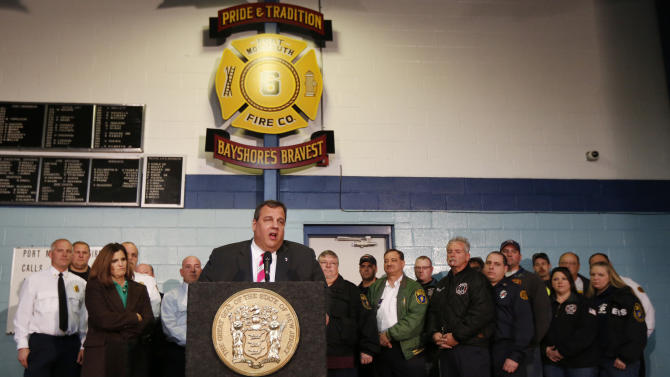 "New Jersey Gov. Chris Christie, center, talks during a news conference at at fire house, Monday, Nov. 26, 2012, in Middletown, N.J. Christie announced he will seek re-election to a second term. Christie says he want New Jerseyans to know that he's ""in this for the long haul"" as he leads the state's recovery from Superstorm Sandy.  (AP Photo/Julio Cortez)"