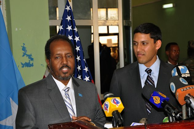 Somali President, Hassan Sheikh Mohamud, left and the USAID administrator Rajiv Shah, right, at a joint press conference at Mogadishu airport, Somalia, Thursday, Feb. 21, 2013. Shah who made the first visit by a high ranking US administration official for years in Somalia has announced $20 million in new funding to support health and education programs, noting the U.S. also wants to help Somalia fight corruption. (AP Photo)
