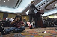 Shaan Thind, 2, eats a candy while Federal Liberal Party leadership candidate Justin Trudeau speaks to supporters during a rally in Richmond, British Columbia October 3, 2012. REUTERS/Andy Clark