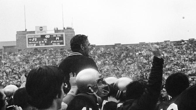 FILE - In this Oct. 27, 1973, file photo, Notre Dame head coach Ara Parseghian is hoisted up by players after their 23-14 win over Southern California in an NCAA college football game in South Bend, Ind. Three field goals by Bob Thomas, an 85-yard touchdown run by Eric Penick and stingy run defense helped Notre Dame end Southern California's winning streak at 23 games. The Associated Press takes a look at some of the memorable games in college football's greatest intersectional rivalry in anticipation of Southern California hosting No. 1 Notre Dame on Saturday, Nov. 24, 2012. (AP Photo/File)