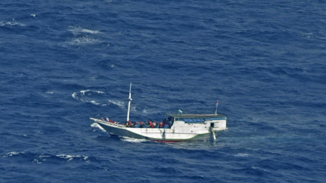 In this photo released by the Indonesian National Search And Rescue Agency, a wooden boat which is believed to have up to 180 asylum seekers on board floats on the waters off Christmas Island, Australia, Wednesday, July 4, 2012. Australian rescuers were trying to help the boat in bad weather and rough seas off Indonesia on Wednesday, a day after the countries agreed to strengthen maritime ties to combat people smuggling. (AP Photo/Indonesian National Search and Rescue Agency)
