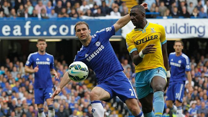 Branislav Ivanovic outplays Crystal Palace's Yannick Bolasie during Chelsea's title-winning match at Stamford Bridge on May 3, 2015
