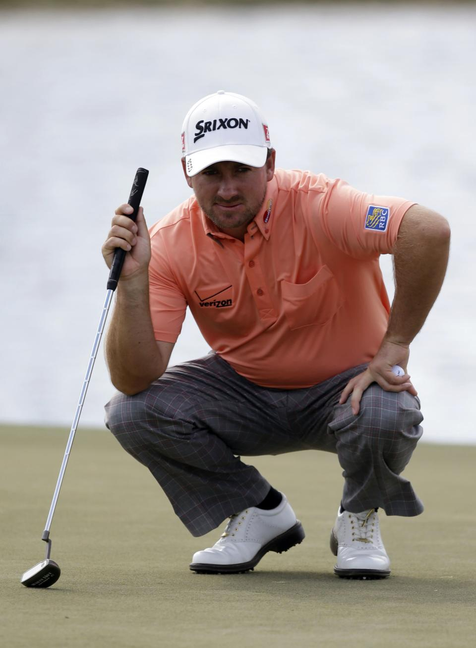 Graeme McDowell, of Northern Ireland, looks at his shot on the eighth green during the third round of the Cadillac Championship golf tournament on Sunday, March 10, 2013, in Doral, Fla. (AP Photo/Wilfredo Lee)