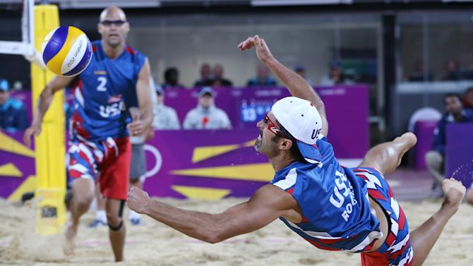 Phil Dalhausser, left, of US looks on as his teammate Todd Rogers, right, dives for a ball during their Beach Volleyball match against Japan at the 2012 Summer Olympics, Sunday, July 29, 2012, in London. (AP Photo/Petr David Josek)